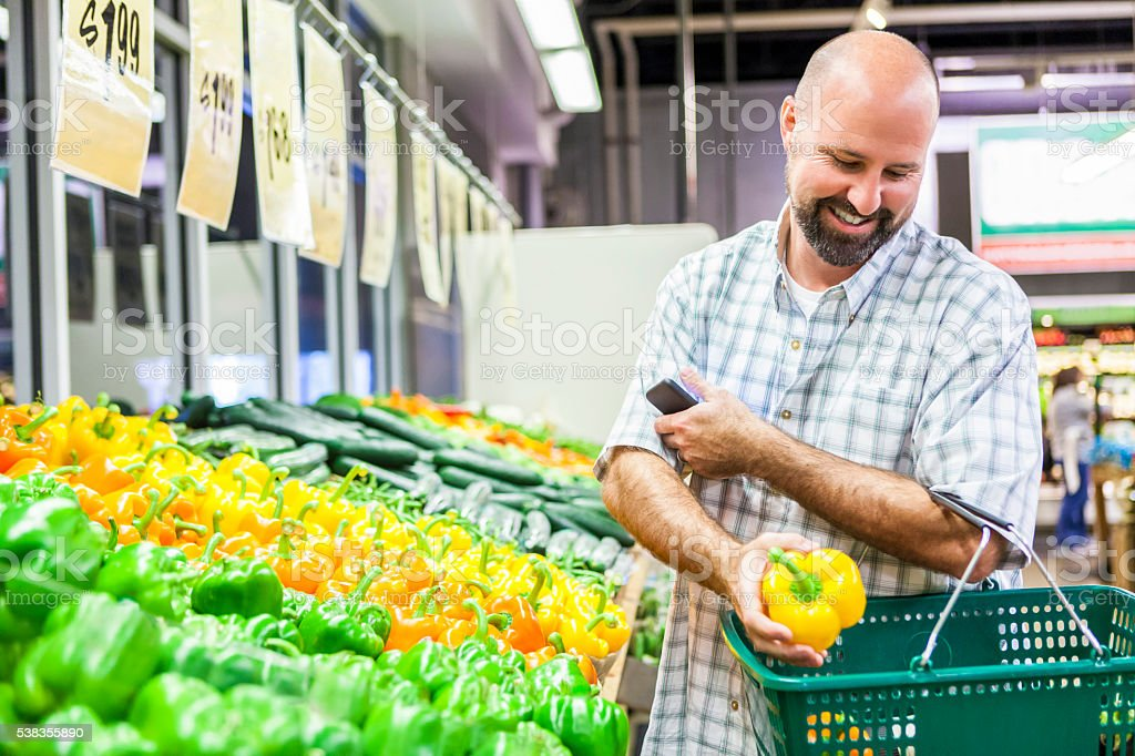 Shopper picking out fresh produce stock photo