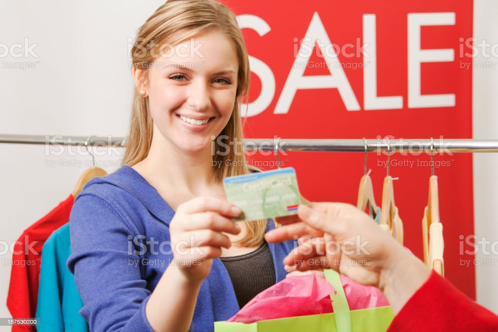Shopper Using Credit Card for Purchases in Fashion Boutique royalty-free stock photo