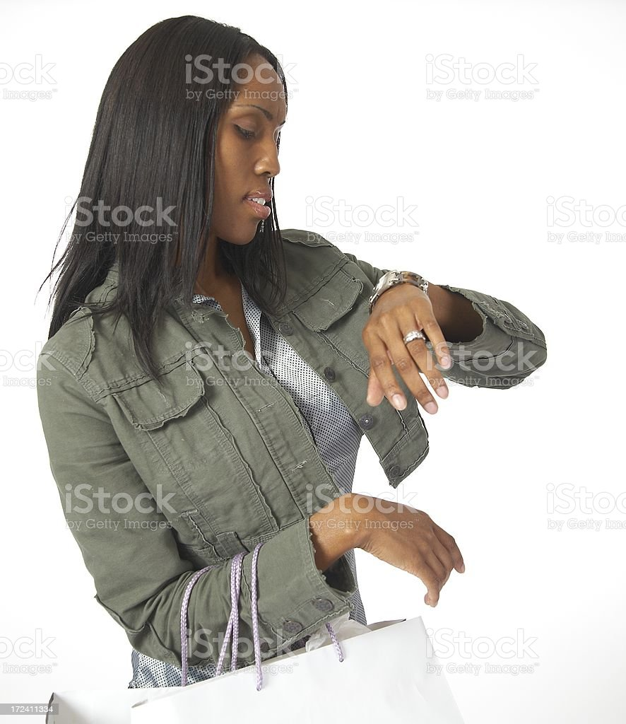 Shopper watching the time royalty-free stock photo