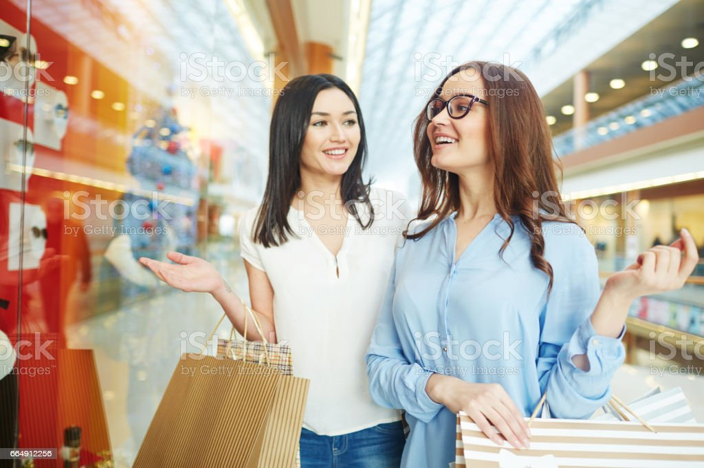 Shoppers by display stock photo