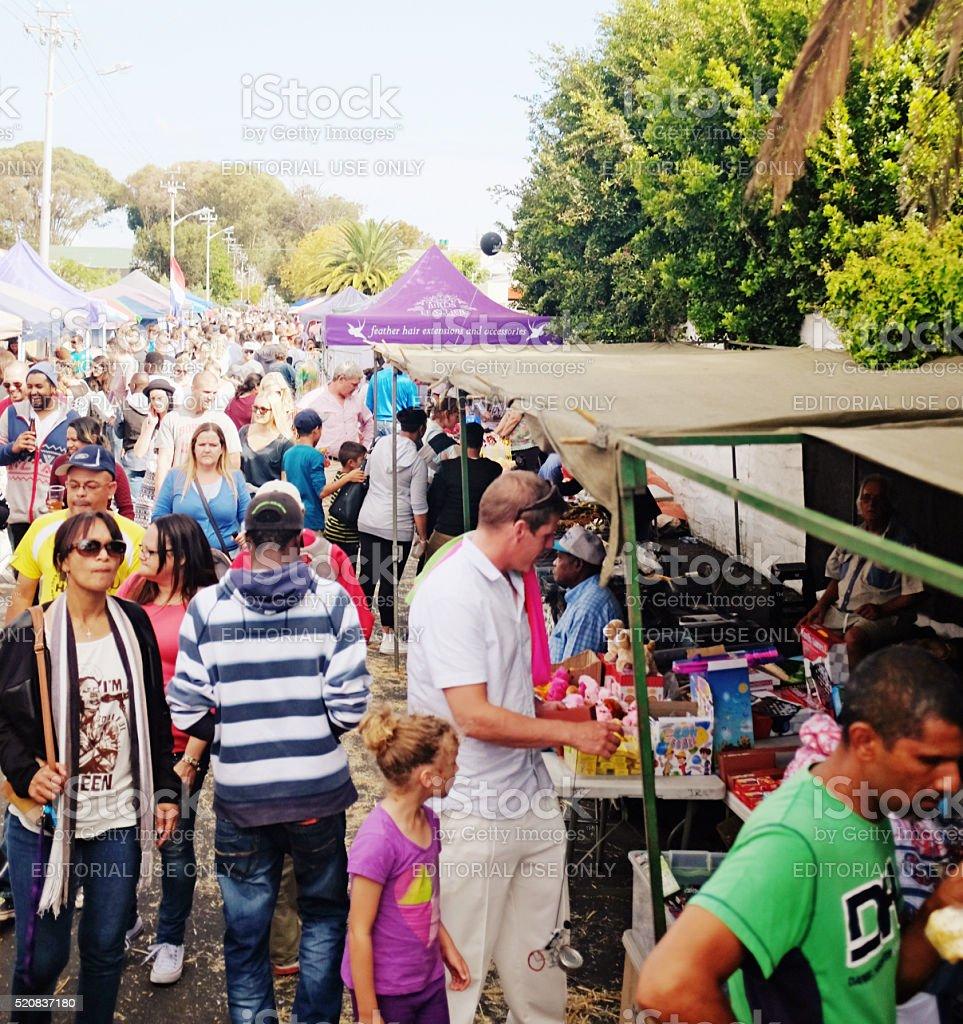 Shoppers crowd market stalls at CapeTown suburban street festival stock photo