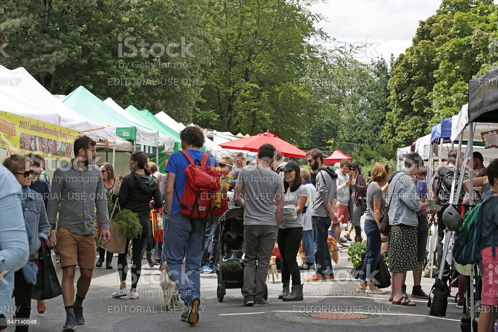 Shoppers Explore Trout Lake Farmers Market, Vancouver, British Columbia, Canada stock photo