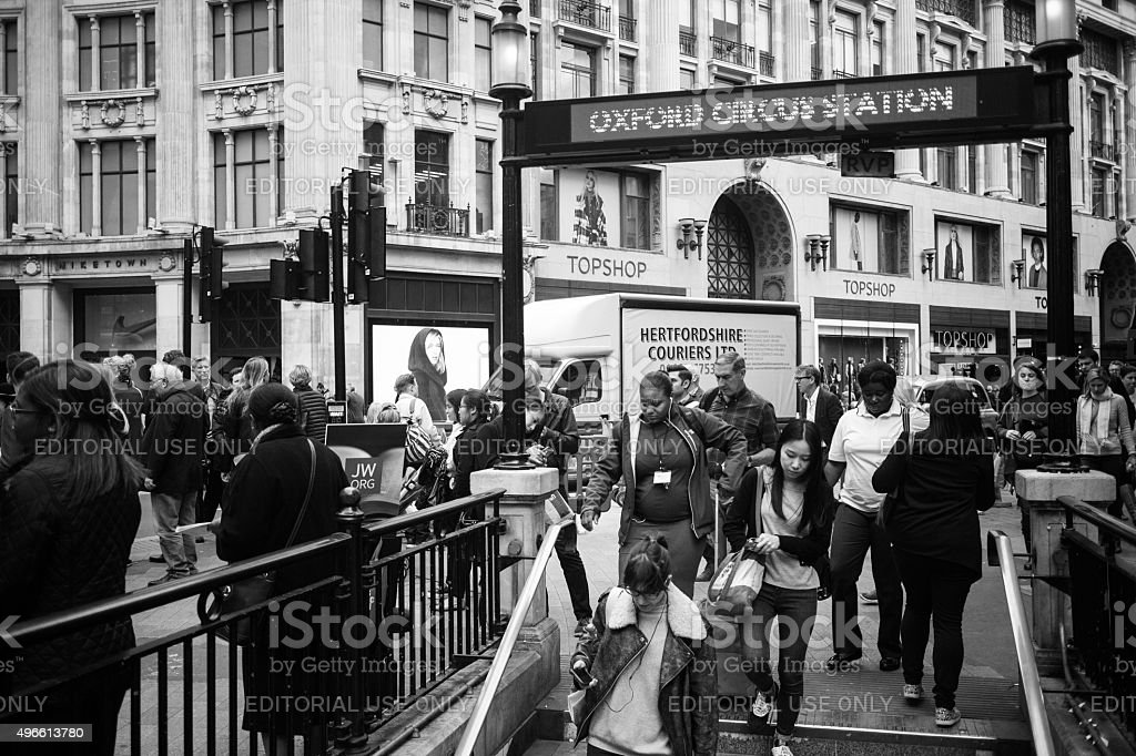 Shoppers flow into and out of Oxford Circus underground station stock photo
