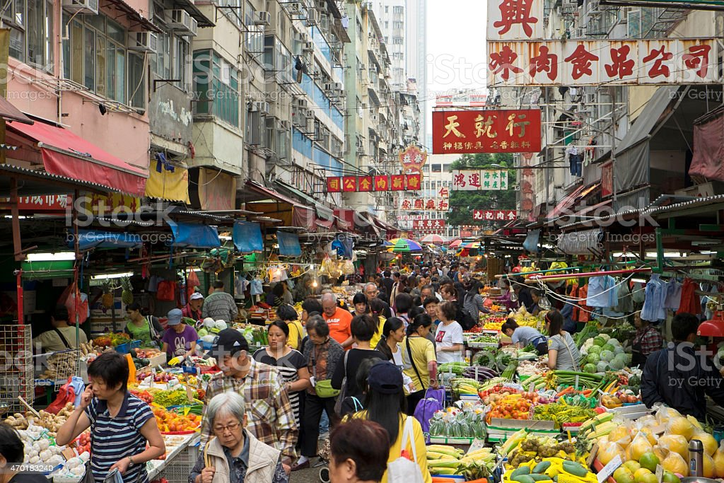 Shoppers in Hong Kong Daytime Market stock photo