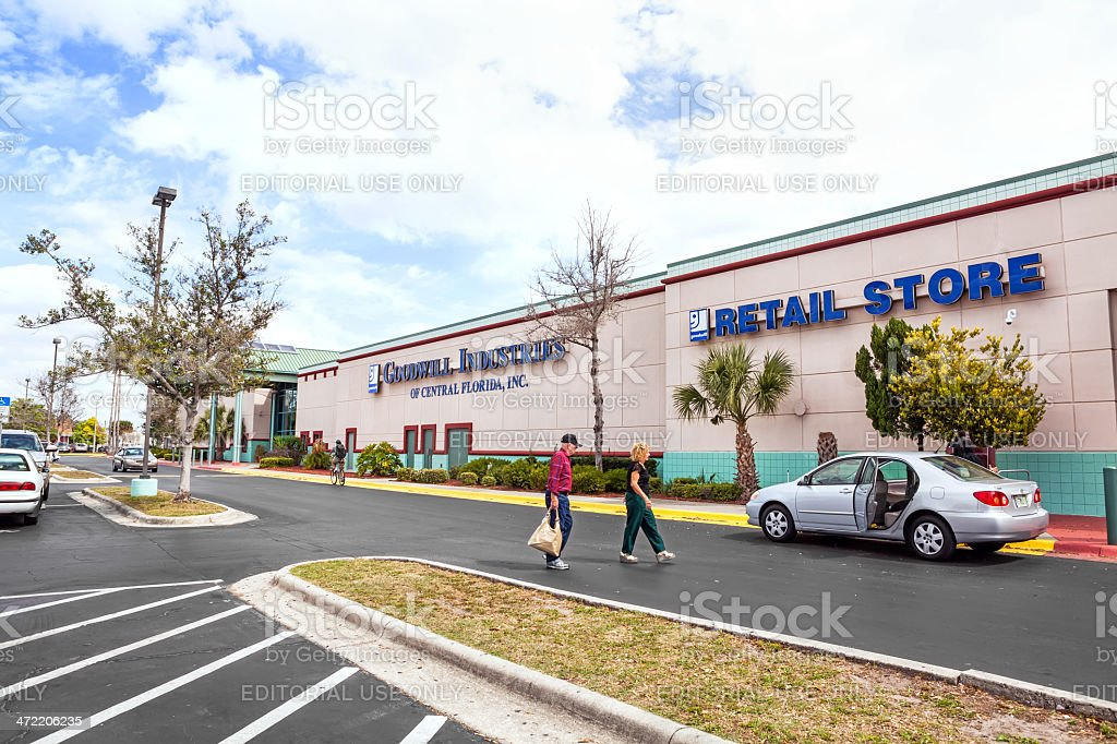 Shoppers leave a Goodwill retail store with their purchases royalty-free stock photo