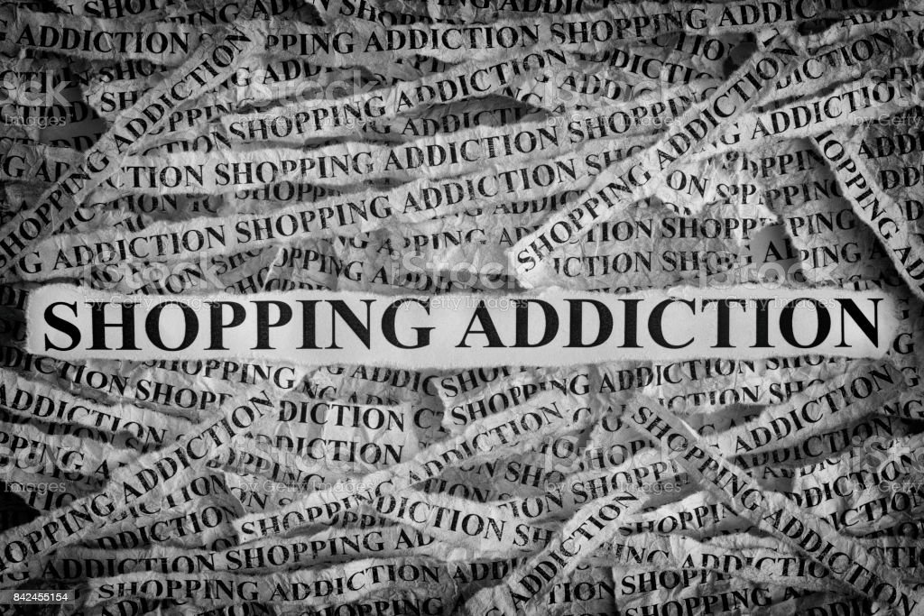 Shopping Addiction. Torn pieces of paper with the words Shopping Addiction stock photo