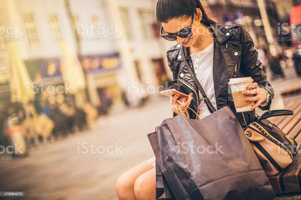 Shopping and texting stock photo
