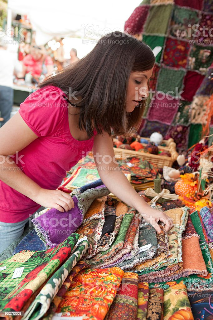 Shopping at a Craft Show royalty-free stock photo