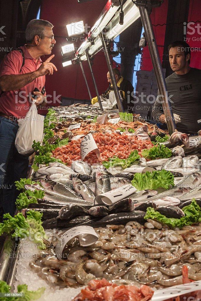Shopping at Rialto Fish Market Venice Italy stock photo