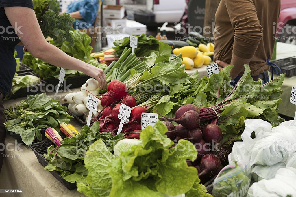 Shopping at your local farmers market. stock photo