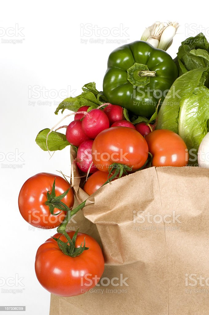 Shopping bag flowing with fresh vegetables royalty-free stock photo