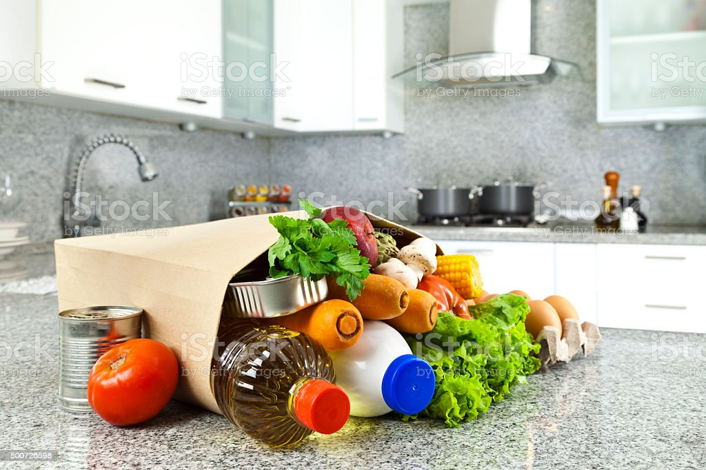 Kitchen Counter With Food groceries kitchen counter pictures, images and stock photos - istock