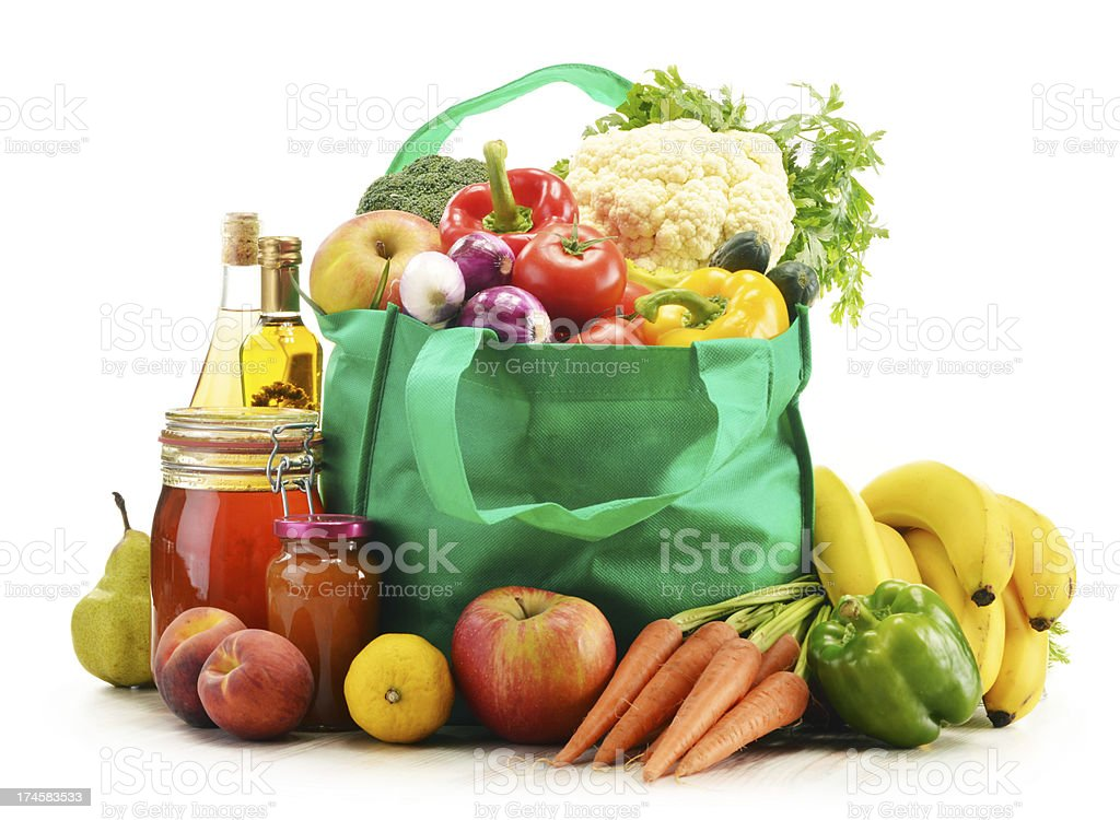 Shopping bag with grocery products isolated on white royalty-free stock photo