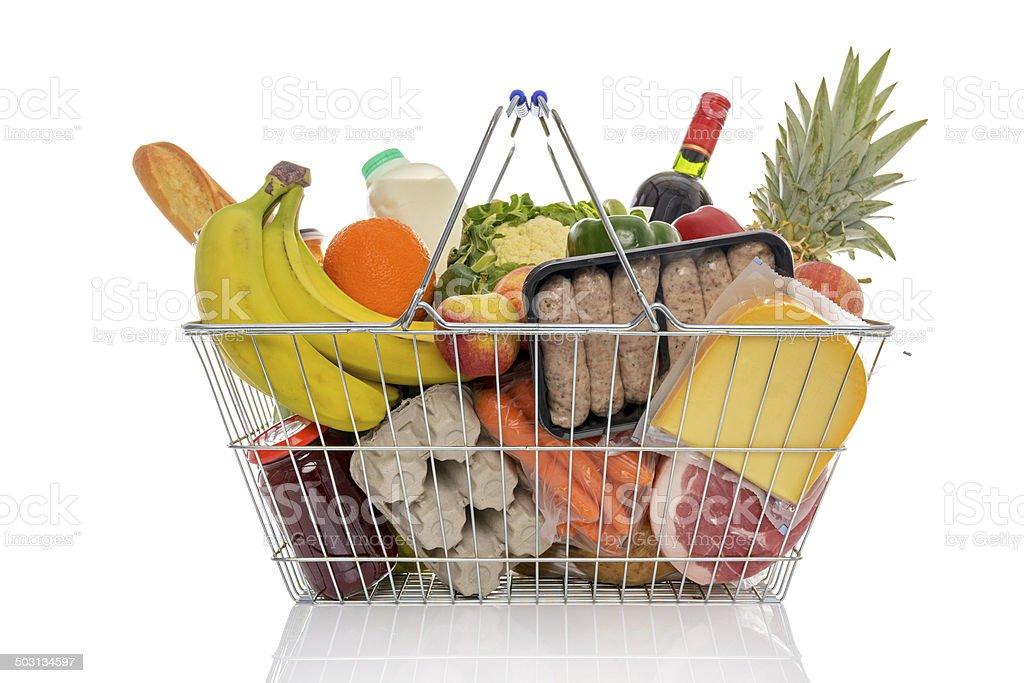 Shopping basket full of fresh food isolated on white. stock photo