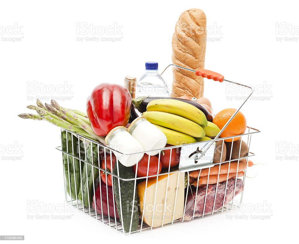 Shopping basket full of fruits, vegetables and heathy food stock photo