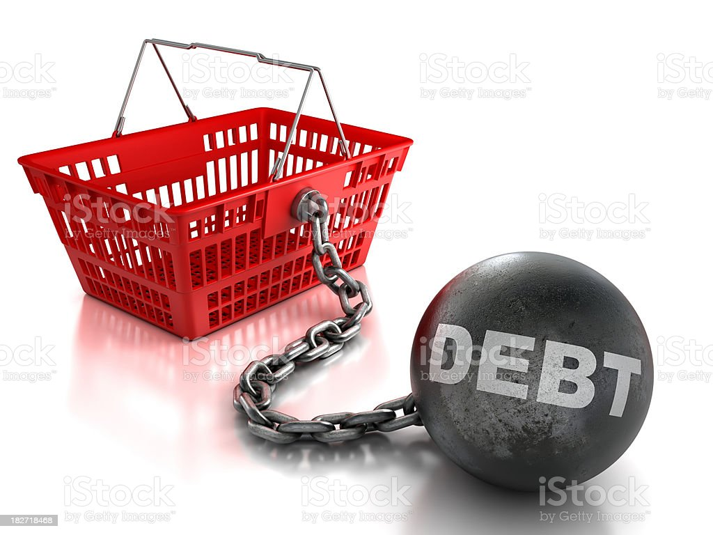 Shopping basket tied to ball and chain of debt, isolated royalty-free stock photo