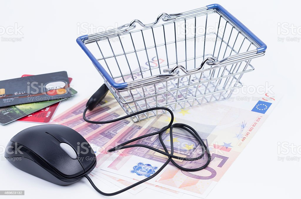 Shopping basket with cash and mouse stock photo