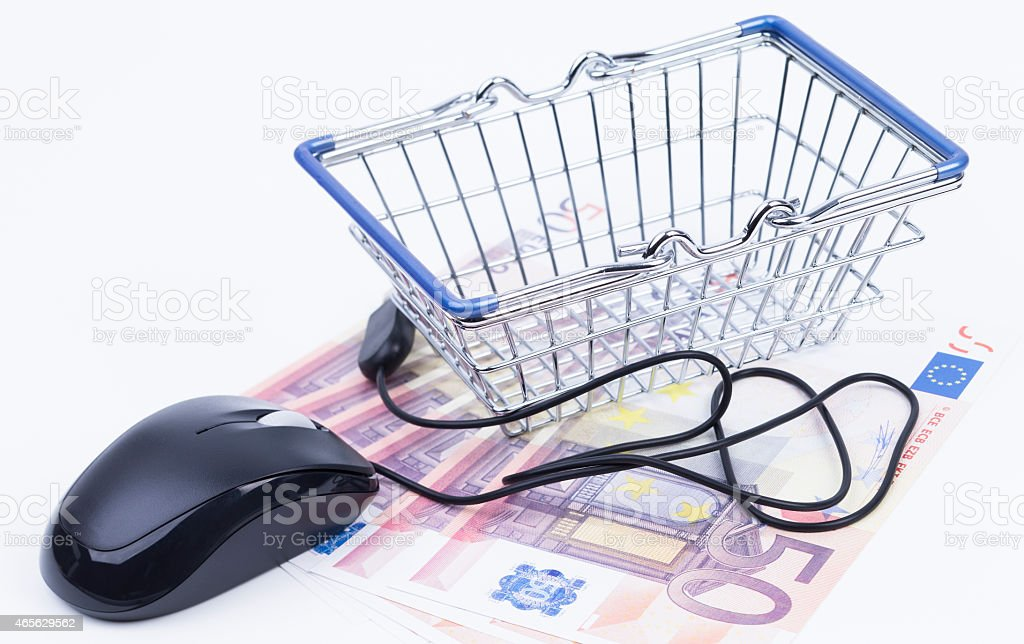 Shopping basket with money and mouse stock photo