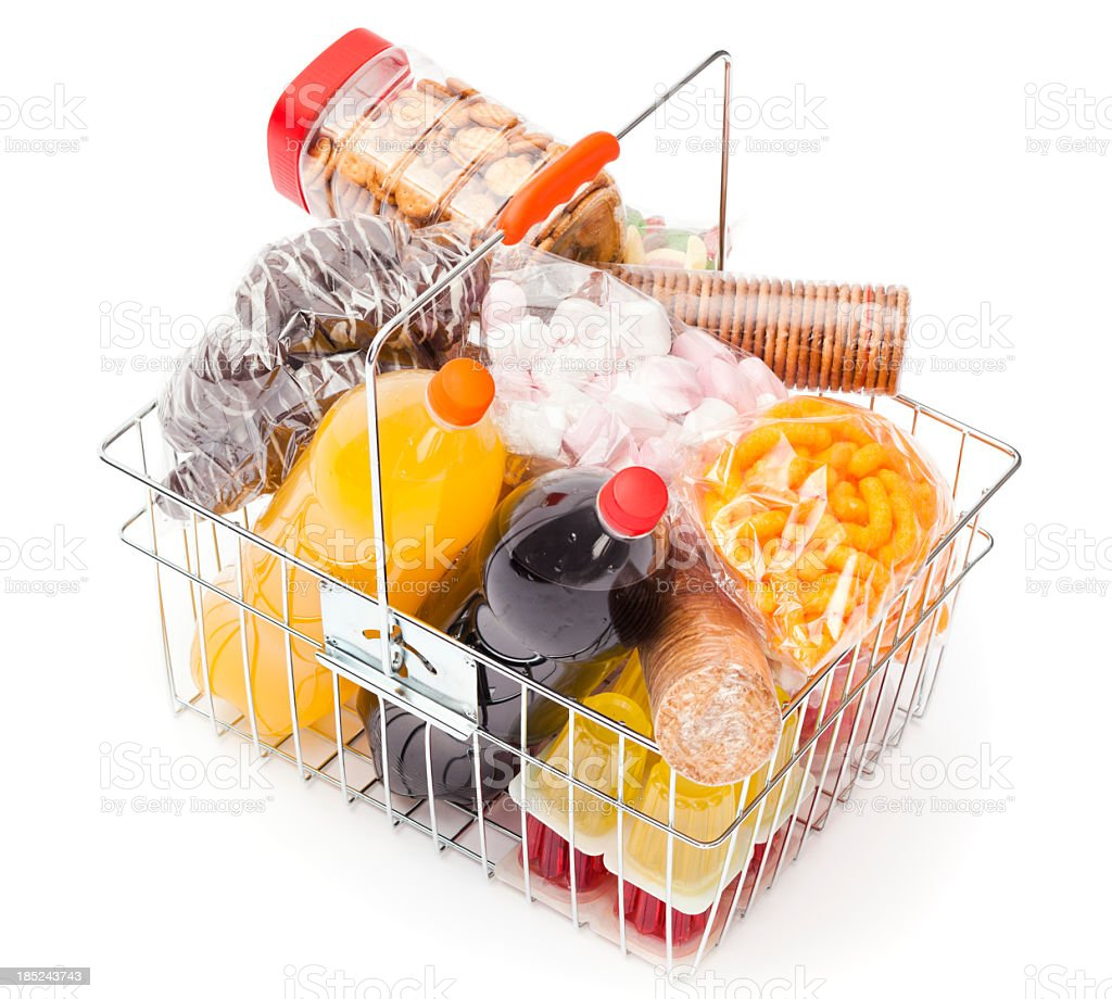 Shopping basket with unhealthy food stock photo
