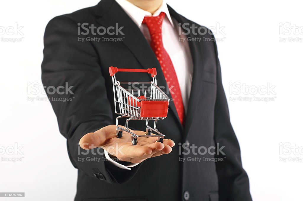 Shopping cart and businessman royalty-free stock photo