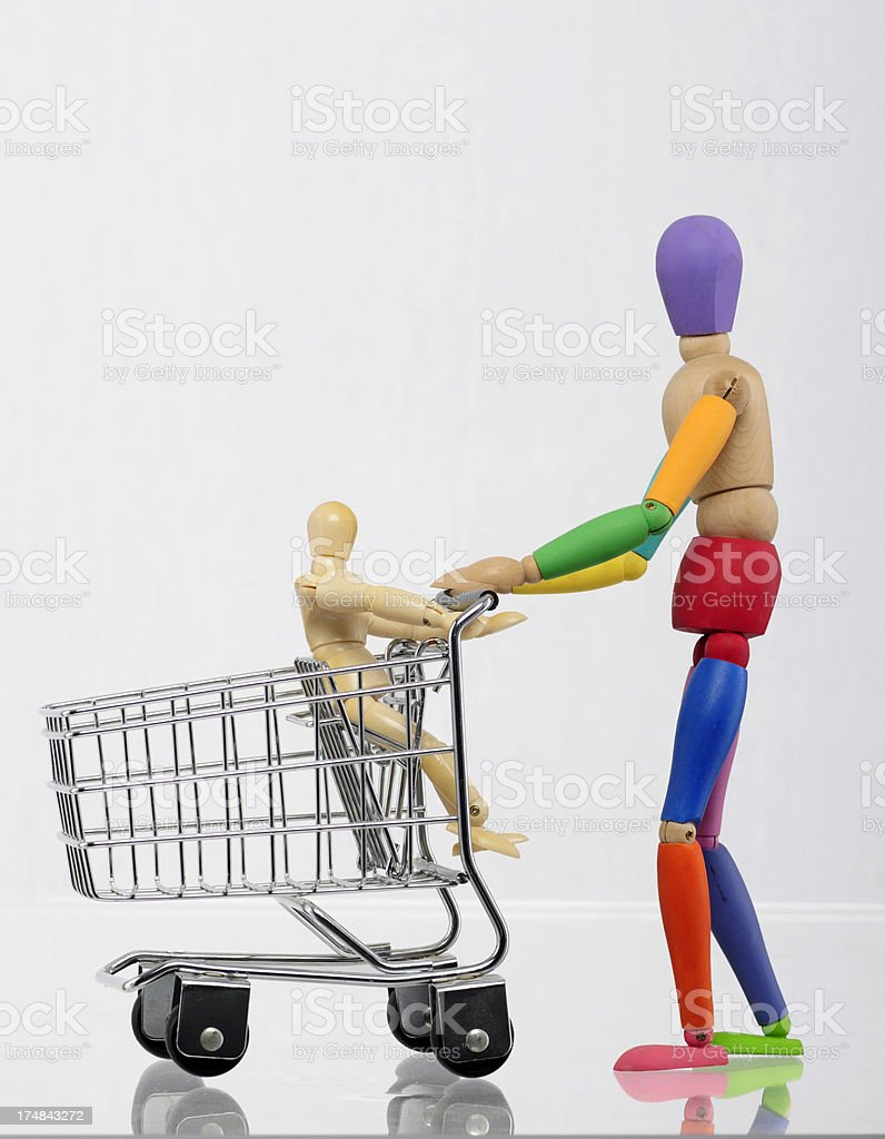 shopping cart and mannequins royalty-free stock photo
