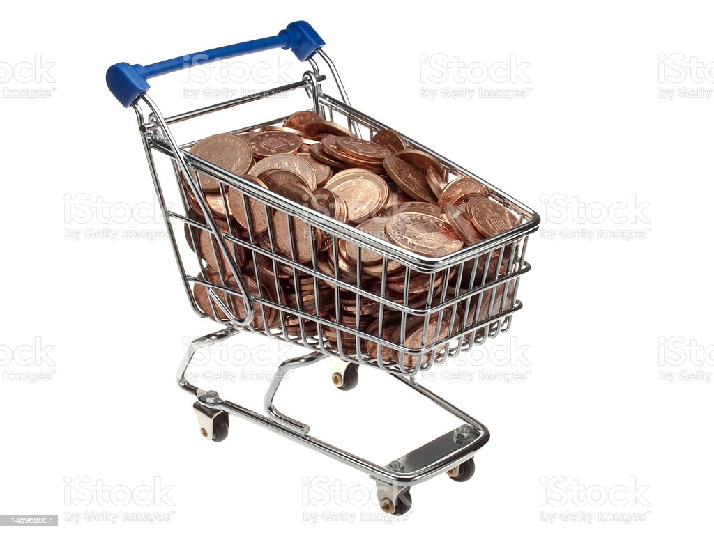 Shopping cart filled with British pennies royalty-free stock photo