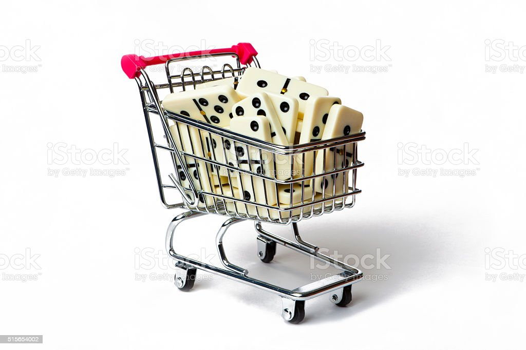 Shopping Cart Full of Domino Pieces stock photo