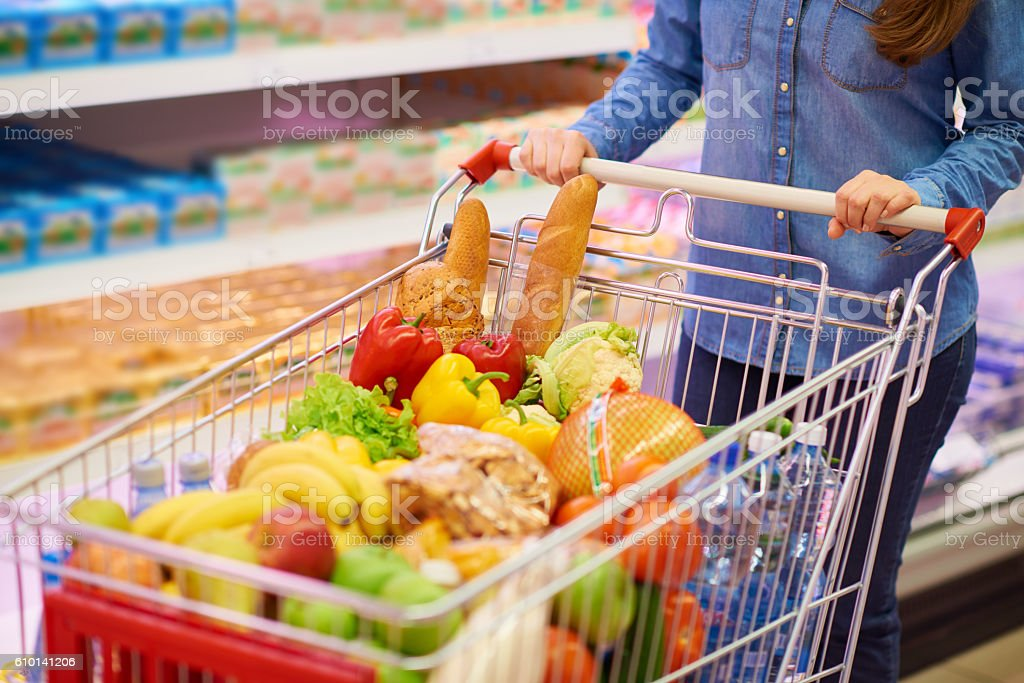 Shopping cart full of products stock photo
