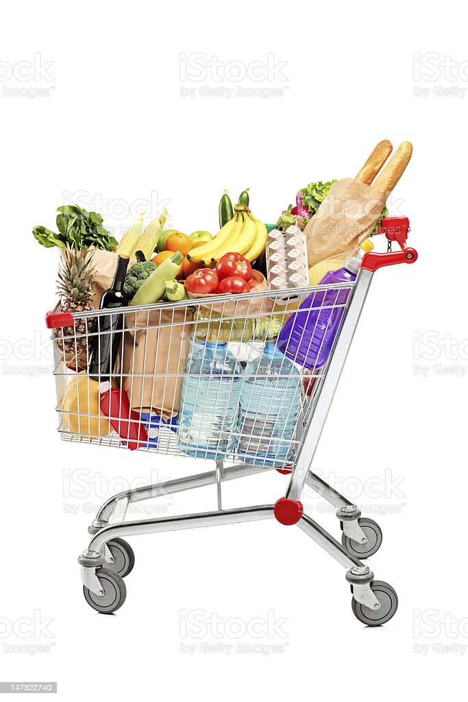 Shopping cart full with groceries stock photo