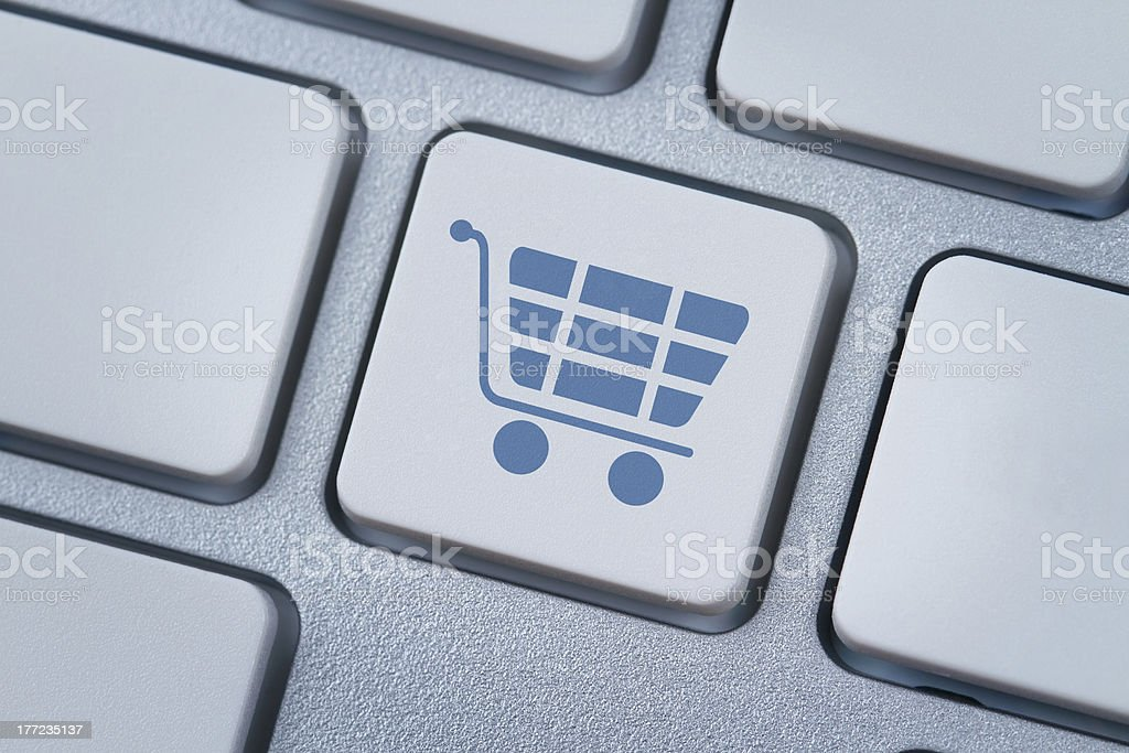 Shopping cart icon at the computer key royalty-free stock photo