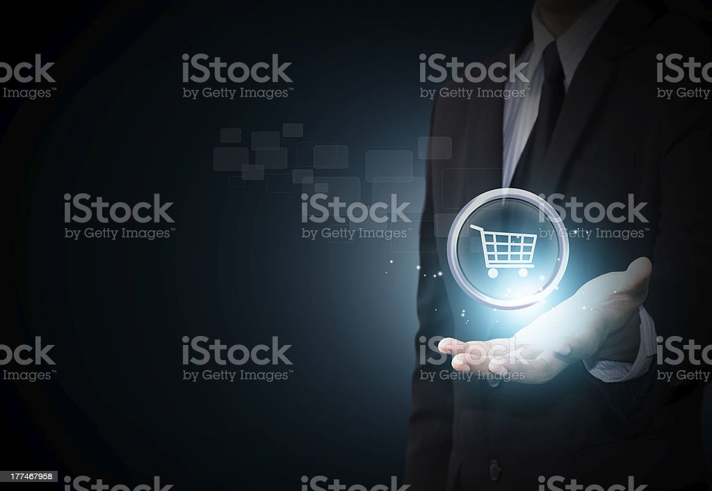 Shopping cart icon in business hand stock photo