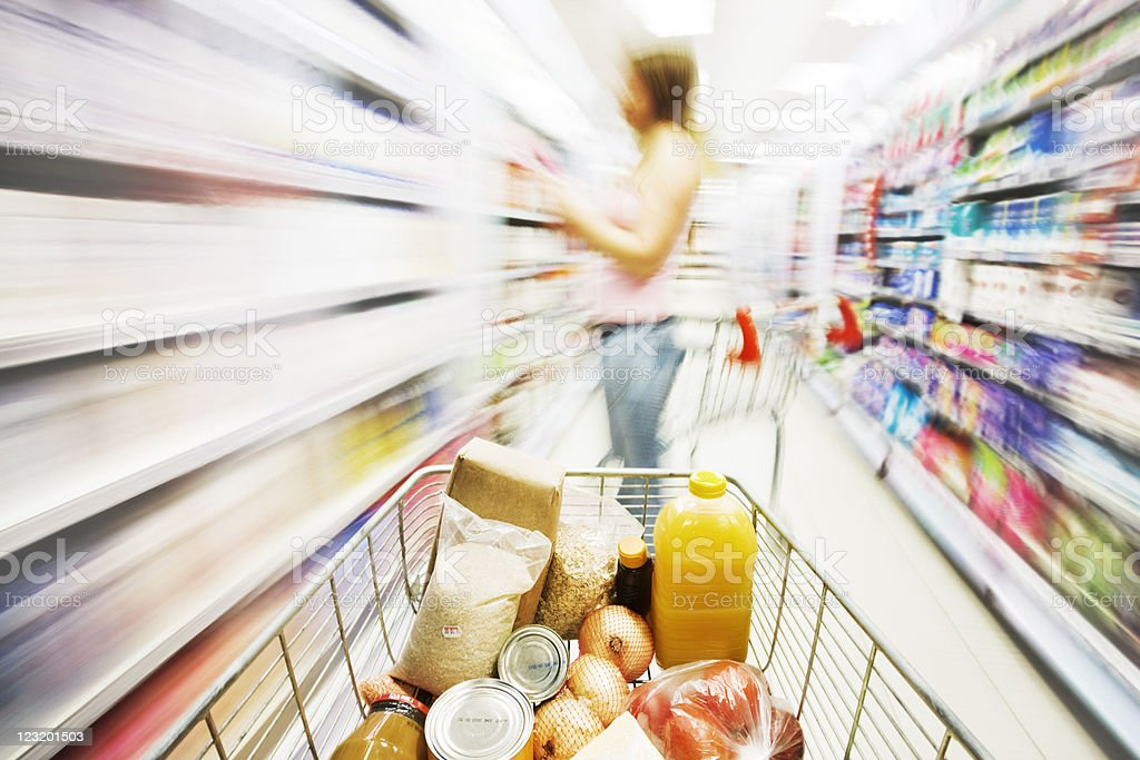Shopping cart in store with motion blur royalty-free stock photo