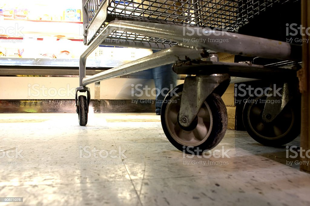 Shopping Cart in Supermarket - Floor Level View royalty-free stock photo