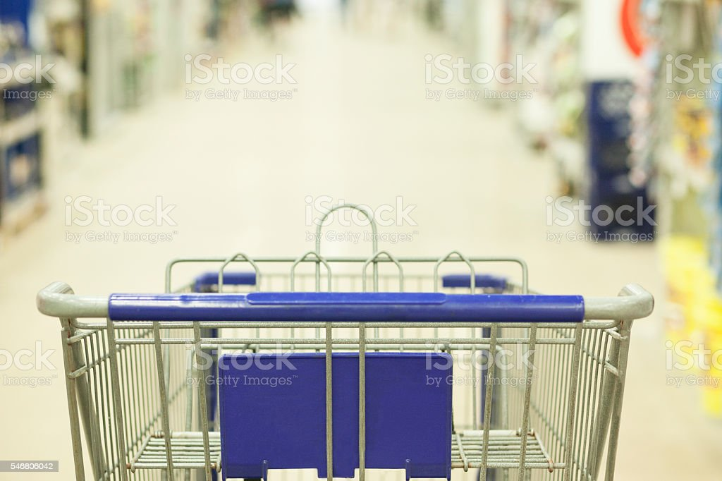 Shopping cart in supermarket or large retail store. stock photo