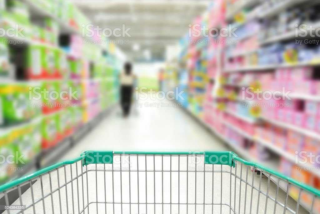 Shopping Cart in supermarket with People stock photo