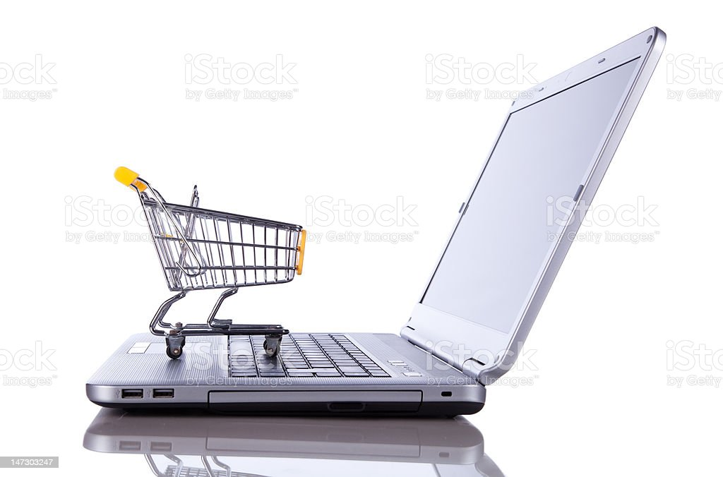 Shopping cart on laptop computer stock photo