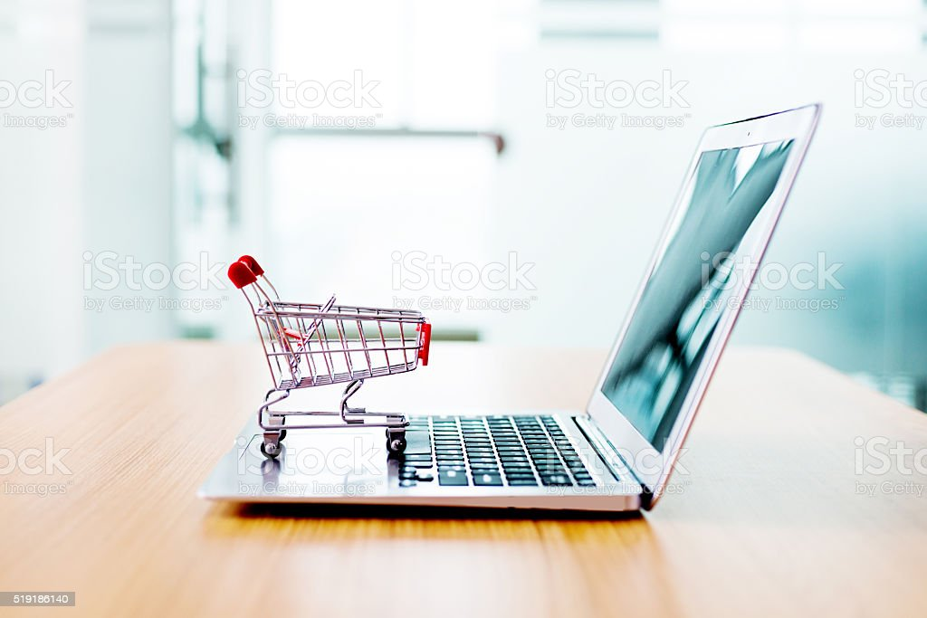 Shopping cart on laptop stock photo