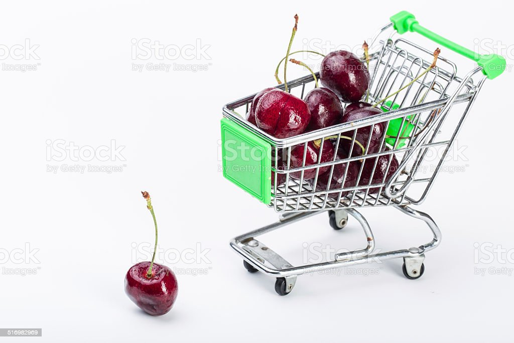 Shopping cart with cherries stock photo