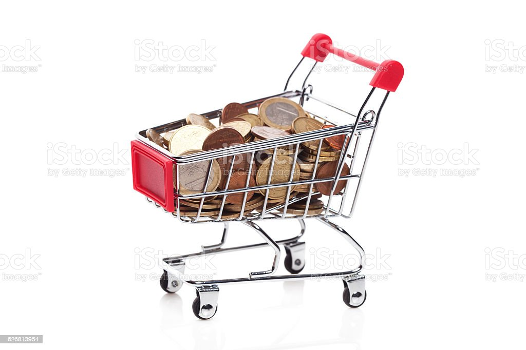 Shopping cart with  coins stock photo