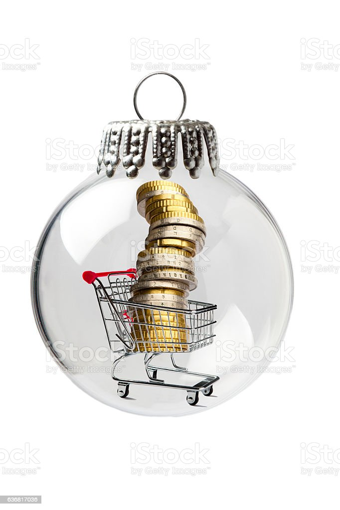 Shopping Cart with Column of Coins in a Christmas Ornament stock photo