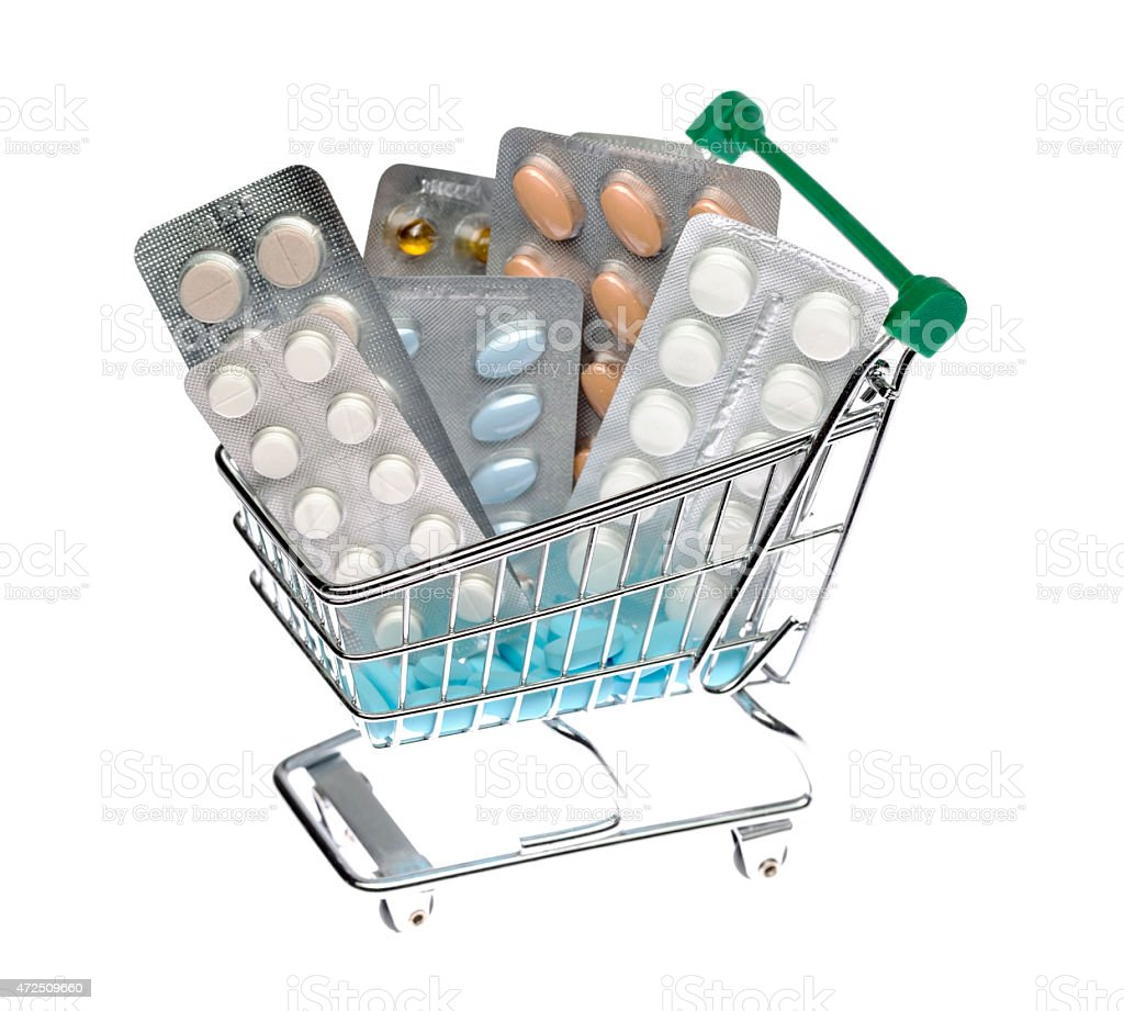 Shopping cart with different pills blister pack stock photo