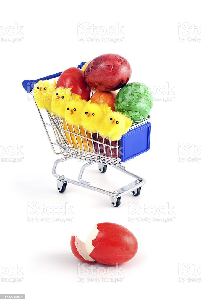shopping cart with easter eggs young chicken sitting in there royalty-free stock photo