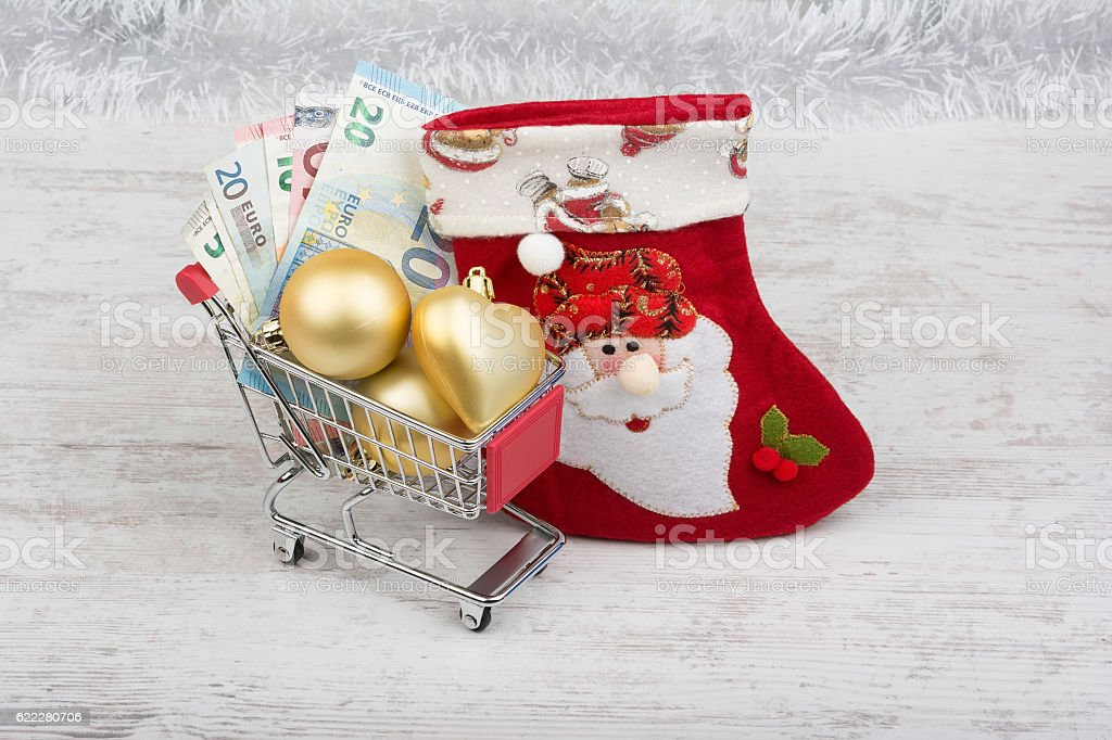 Shopping cart with euro banknotes and Christmas decoration stock photo