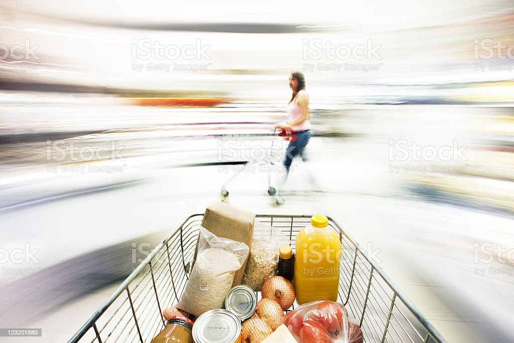 Shopping cart with extreme motion blur in supermarket stock photo