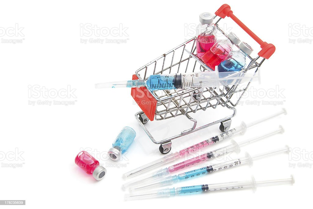 Shopping cart with medicine vials and syringe stock photo
