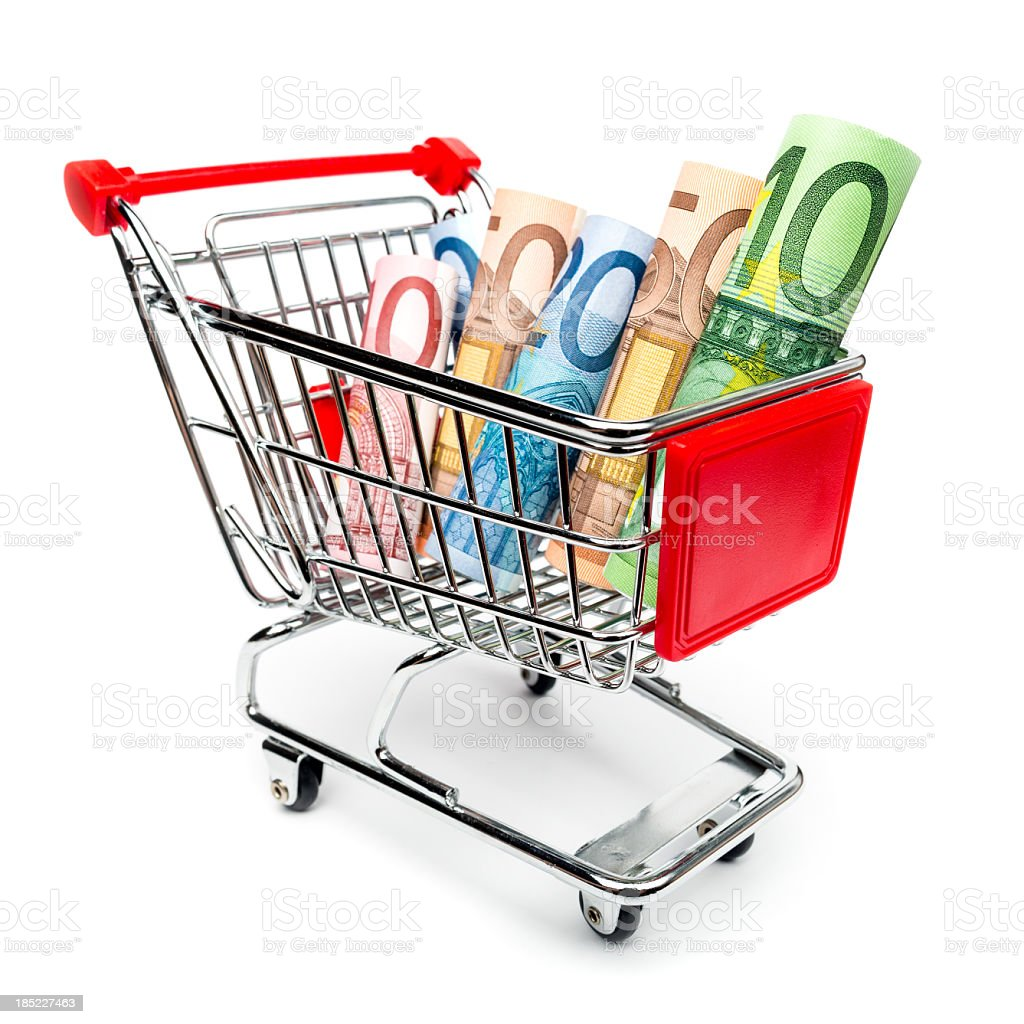 Shopping cart with money inside stock photo