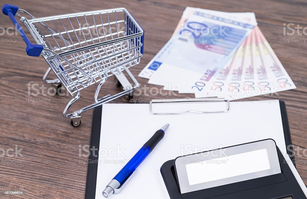 Shopping cart with notepad stock photo