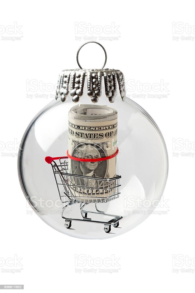 Shopping Cart with US Paper Rolled in a Christmas Ornament stock photo