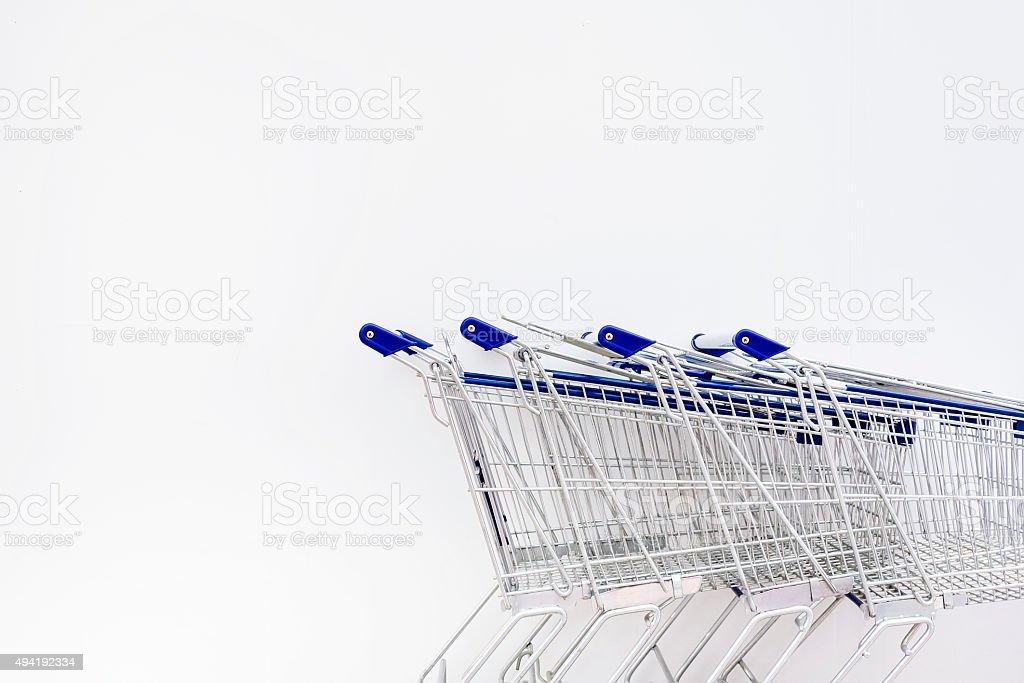 Shopping Carts row on white wall stock photo