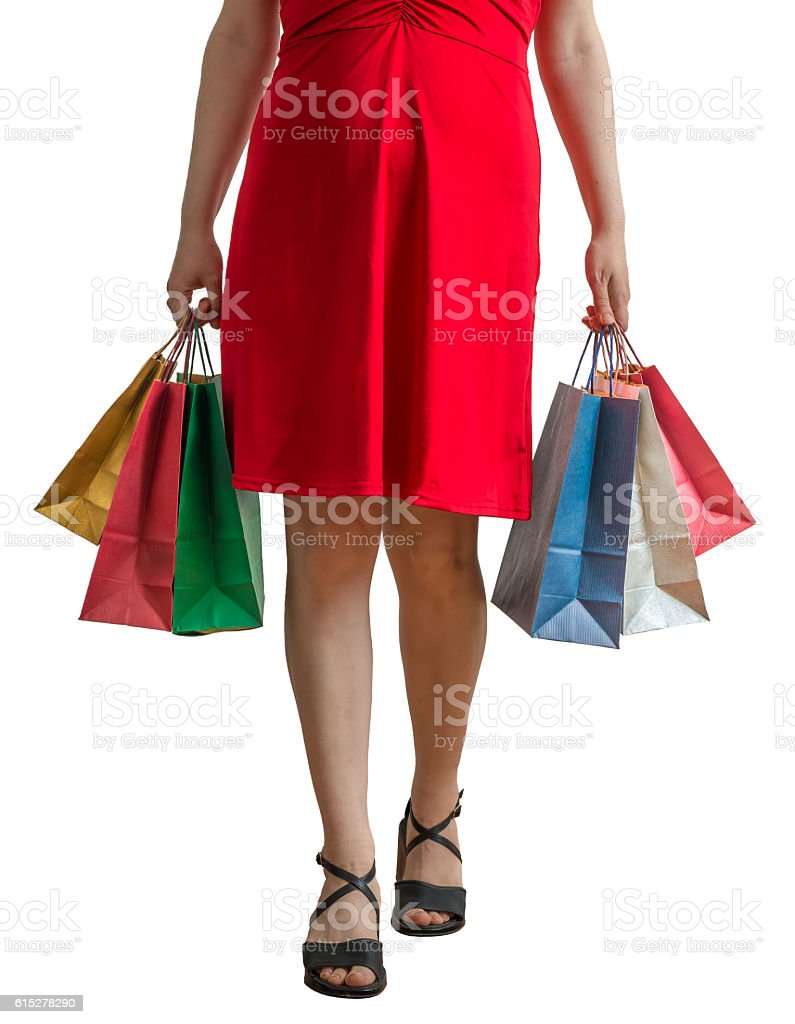 Shopping concept. Young woman holds many shopping bags. stock photo